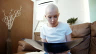 Sad, depressed cancer patient woman reading her diagnosis video