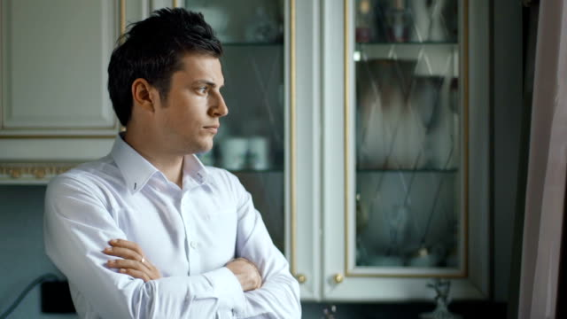Sad disappointed man looking out of the window video