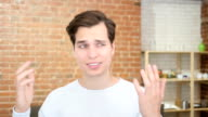 Sad freelance male worried watching bad news on line , failure video