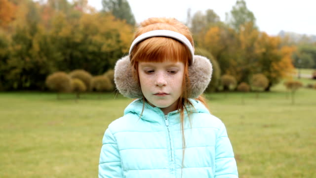 sad ginger girl in the earmuffs video