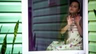 Sad Girl Sitting At Window And Looking At Rain video