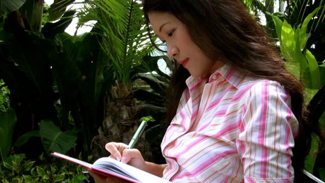 Sad girl writes in diary. video