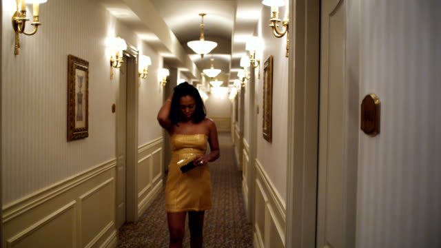 Sad party girl in hotel corridor video
