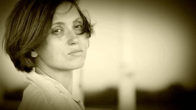 Sad Pretty woman portrait on the windy street video