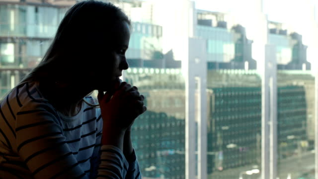 Sad woman being deep in thoughts and then looking out video