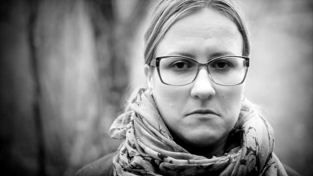Sad woman. Close up. Black and white video