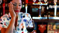 Sad woman having red wine video