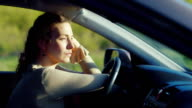 A sad woman is sitting in the car. Very upset. Depression, women's problems video