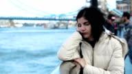 sad woman near the river in London video