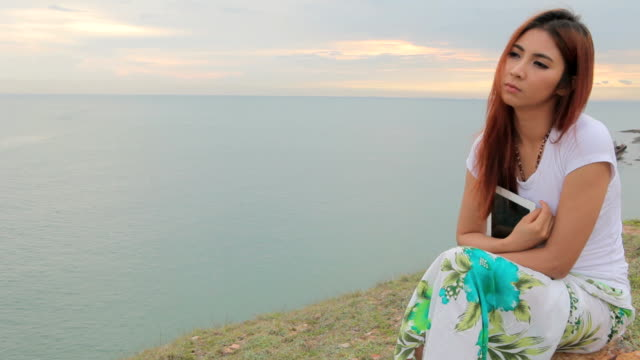 Sad woman on the mountain and sea video