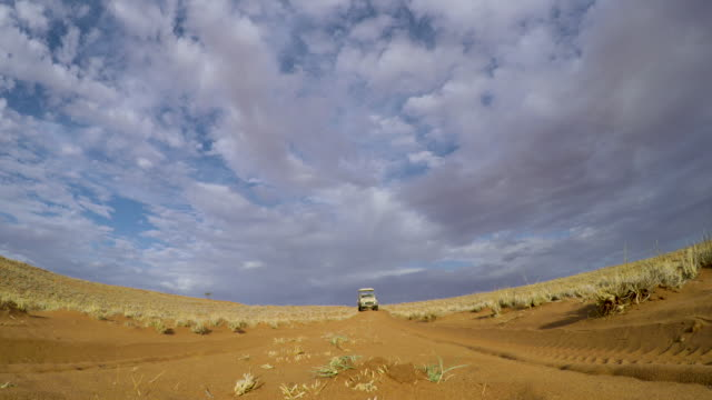 Safari vehicle driving over a Gopro camera in the Namib desert video