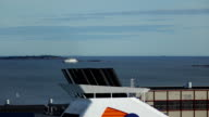 Sail at distance ferry seen blurred through funnel venting steam of cruise liner video