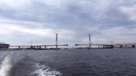 Sail away from city at Petrovskiy channel, to Gulf of Kronstadt, view back video
