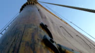 A sail mast of the ship with a big cloth for sailing GH4 4K video