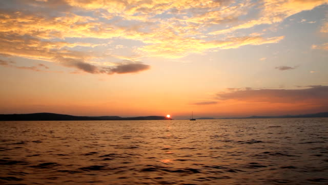 Sailboat in the bay at sunset video