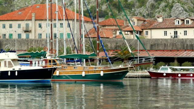 Sailboat near old town of Kotor, Bay of Kotor, Montenegro video