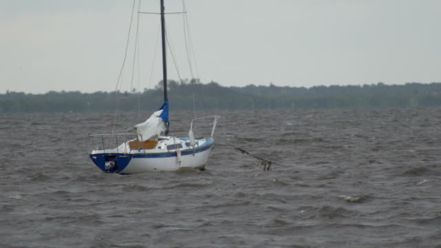 Sailboat rocking in stormy waters video