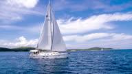 WS Sailboat Sailing Along The Coastline video