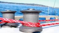 Sailboat winch raises main sail 1080p HD video