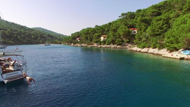 AERIAL Sailboats in idyllic bay video