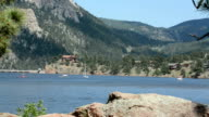 Sailboats on a mountain lake video