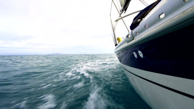 HD: Sailing boat from water line video