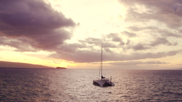 Sailing into the Sunset. Aerial View Flying Over Sail Boat video