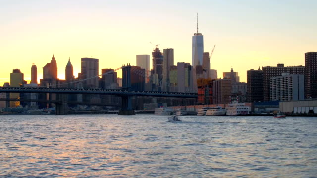 Sailing on East River and observing golden sun setting behind Manhattan skyline video