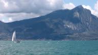 Sailor at Lake Garda with mountain Pizzocolo video