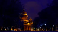 Saint Isaac Cathedral at winter night, as seen from park area video