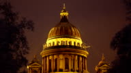 Saint Isaac's Cathedral dome at night, winter season. Dark trees on foreground video