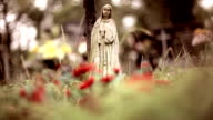 Saint Mary stone statue in the cemetery video