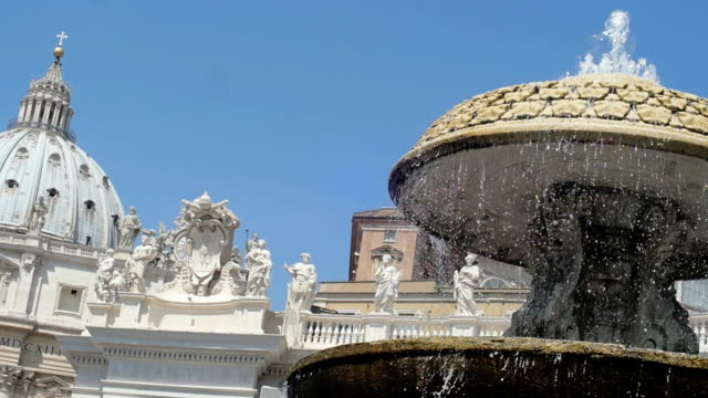 Saint Peters Square views with fountain in foreground. Slowmotion video