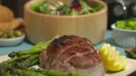 Salad Bowl Tilt Down to Roast Pork Close Up video