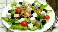 salad with fresh vegetables and feta cheese video