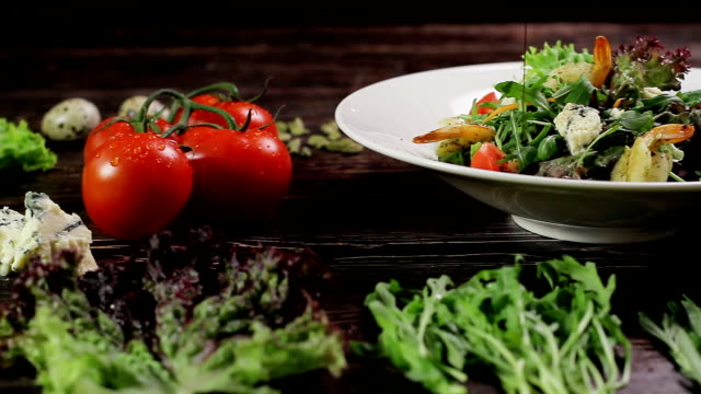 Salad with shrimps and its ingredients. video
