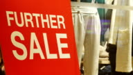 sale sign in window display at storefront in hong kong. video