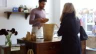 Sales Assistant Serving Customer In Delicatessen Shot On R3D video