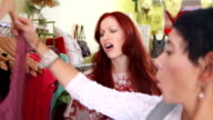 HD: Sales Clerk Assisting Ecstatic Woman In Boutique video