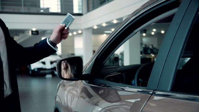 Sales Manager Gives the Client the Keys From the Car video