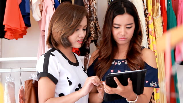 Saleswoman Assisting Customer With A Tablet video