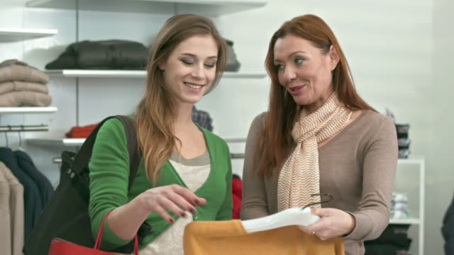 HD: Saleswoman Assisting Young Woman In Boutique video