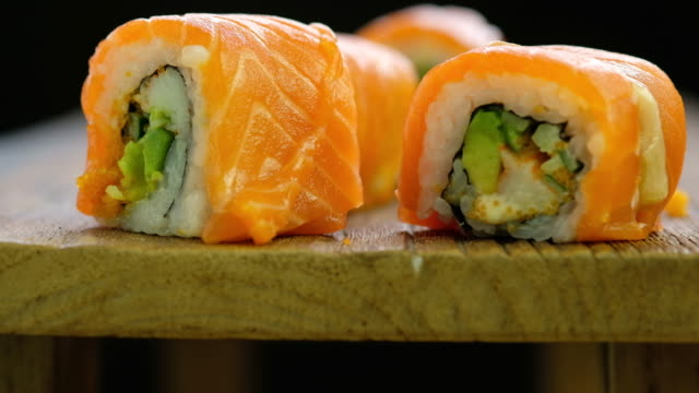Salmon Sushi black background video