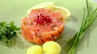 Salmon tartare on green plate rotating video