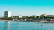 Salou summer morning, swimming tourists, Spain video