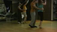 Salsa dancers practicing dancing in dance studio. South American rhythms. video