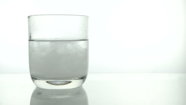 Salt dissolving in warm water video