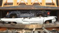 Salvage Yard Car Crusher Smashing Vehicle video