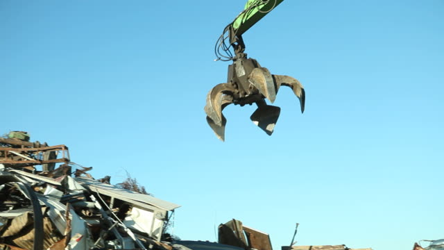 Salvage Yard Grappling Claw Picking Up and Releasing Scrap Metal video