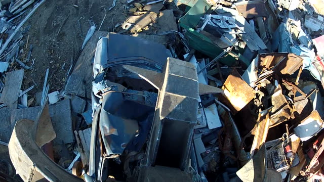 Salvage Yard Grappling Claw Releasing Scrap Car video